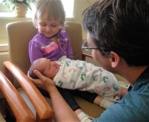 Michaela holding newborn Angelina