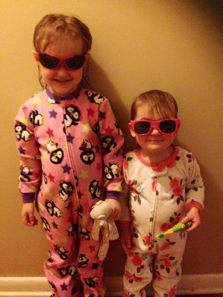 Michaela Brunke with sister in pajamas and sunglasses