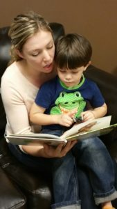 Books for Babies: woman reading to her son