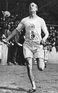 Christian Olympian Eric Liddell crossing the final line.