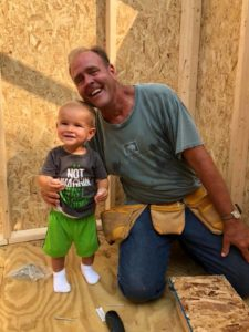 Mike Litzau doing carpentry with Landon Litzau