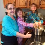My mother-in-law cooking with my daughters